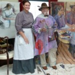 Clare and Bill Gatt beside his two works of her in costume at NMNI Folk Museum